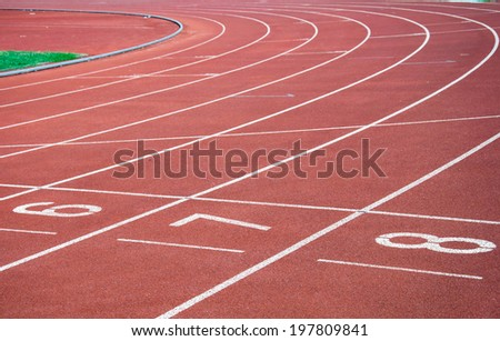 Curve with Number on start point running track - stock photo