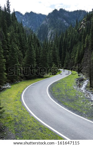 Curved asphalt road in high mountains