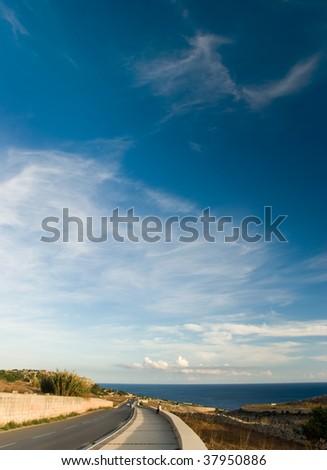Curved coastal road - stock photo