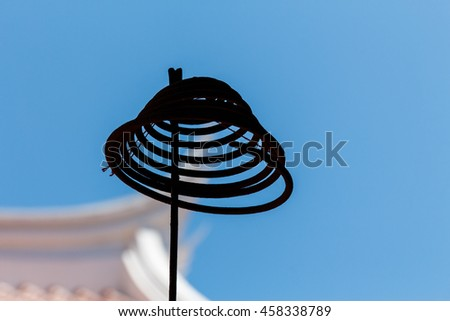 Curved incense with blue sky