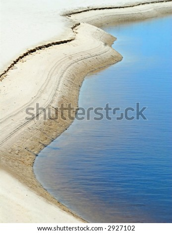 Curved Inlet with Calm Water - stock photo