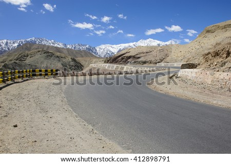 Curved road in high mountain pass in Ladakh