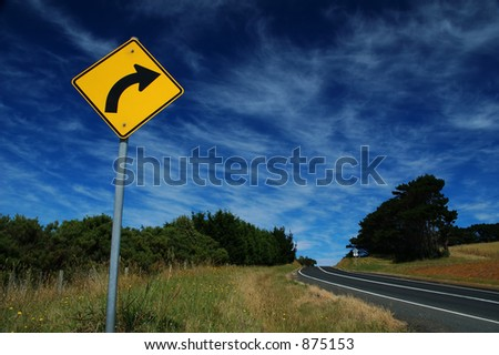 Curved Road Traffic Sign on a a road - stock photo