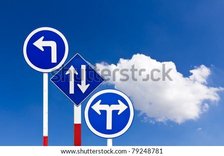 Curved Road Traffic Sign over blue sky,turn left - stock photo