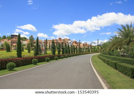 Curved road with the beautiful Italian style building and blue sky on backdrop - stock photo