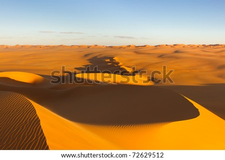 Curved sand dunes at sunset - Murzuq Desert, Sahara, Libya - stock photo