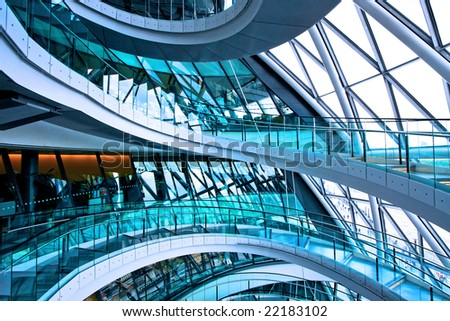 Curved stairway in big glass office building - stock photo