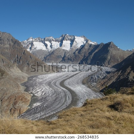 Curved tongue of the Aletsch Glacier, longest glacier in the Alps - stock photo