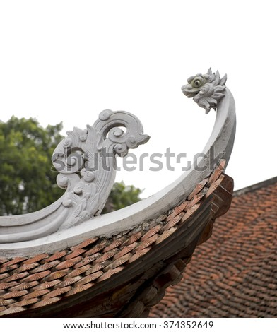 Curved wooden roofs  with a dragon and tiles  on the tower of But Thap Pagoda, Vietnam - stock photo