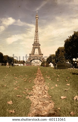Curves of the Eiffel in retro style  under blue sky at shiny day
