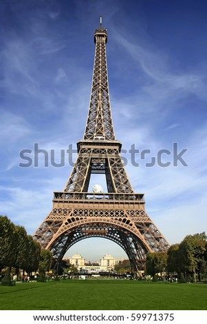 Curves of the Eiffel under blue sky at shiny day - stock photo