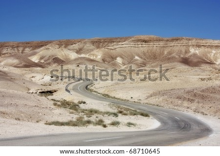 Curvy desert road going up - stock photo