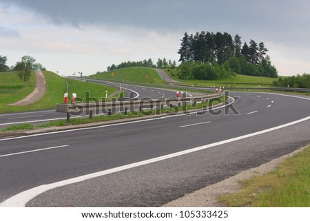 Curvy highway road in mountains in Poland - stock photo