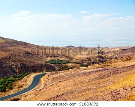 curvy highway with desert landscape in Jordan. - stock photo