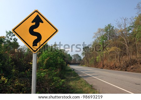 Curvy road sign - stock photo