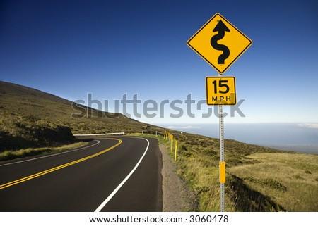 Curvy road sign in Haleakala National Park, Maui, Hawaii. - stock photo