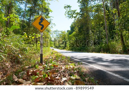 Curvy road sign on a country road - stock photo