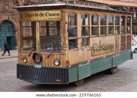 CUSCO, PERU - AUGUST 28, 2014: Wooden tram used to take tourists around the historic city of Cusco in Peru - stock photo