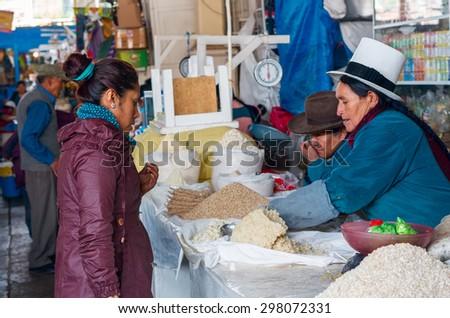 CUSCO, PERU - CIRCA MARCH  2015: Unidentified people at the market in Cusco, Peru - stock photo