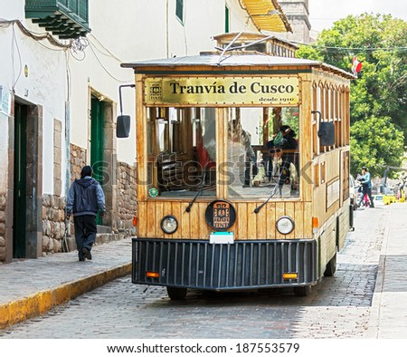CUSCO, PERU - JANUARY 02, 2014: Tourist bus stylized vintage tram in old town Cusco. Declared a World Heritage Site by UNESCO in 1983 - stock photo