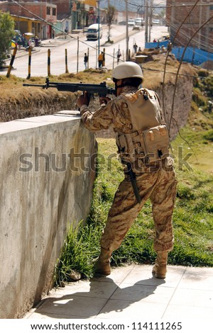 CUSCO, PERU - JULY 19: Peruvian soldier in defense position during the military exercises on July 19, 2012 in Cusco, Peru. - stock photo
