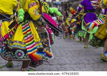 CUSCO - PERU - JUNE 06, 2016 : Peruvian dancers at the parade in Cusco. People in traditional clothes.
