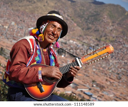 CUSCO, PERU- JUNE 16: Quechua Indian man performs in Cusco, Peru on June 16 2012, Quechua are known worldwide for their traditional and colourful outfit. - stock photo