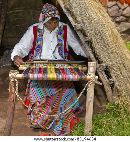 CUSCO PERU . MAY 26 : Unidentified Quechua man weaves with strap loom in Cusco Peru on May 26 2011. Quechua weavers known worldwide for their skills and rich traditions - stock photo