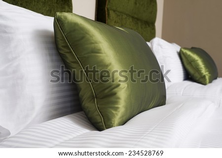Cushions , Green pillows on bed - stock photo
