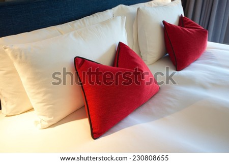 cushions on a bed - stock photo