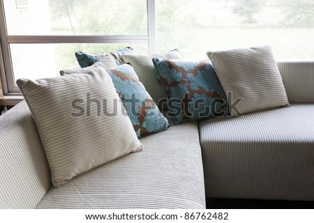 cushions on a sofa set - stock photo
