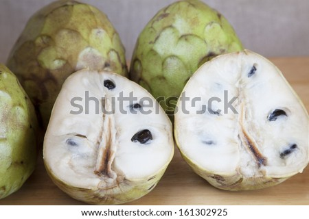 Custard apples open and closed. - stock photo