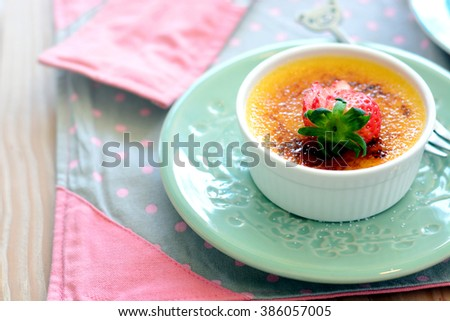 Custard cake with strawberry sliced in plate.