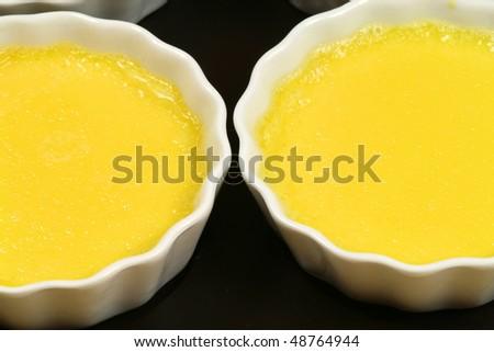 Custard cream creme brulee in white ramekins - stock photo