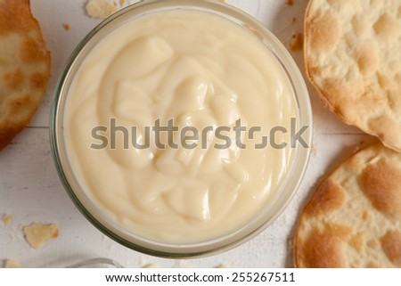 Custard pastry cream on white vintage background. Preparation of sweet pastry custard cream. Pastry filling.