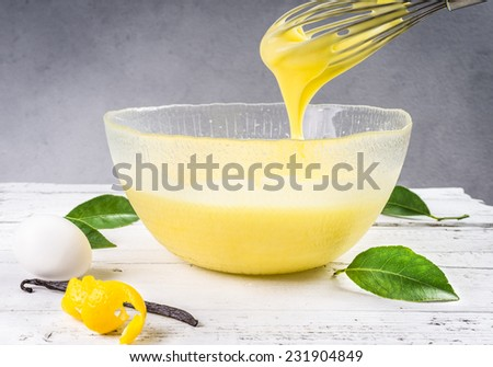 Custard pastry cream. Preparation of sweet cream in a bowl with lemon and vanilla.Pastry filling. - stock photo