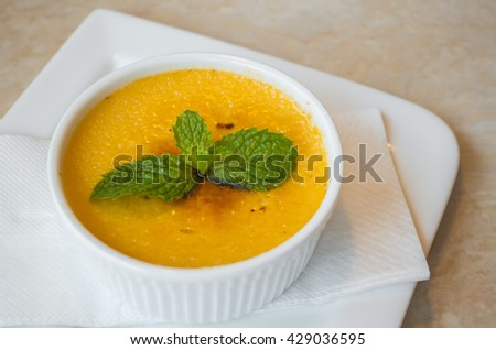 Custard pudding in white plate