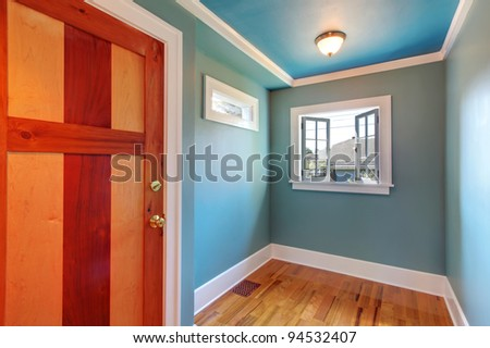 Custom build beautiful wood door in blue empty room - stock photo
