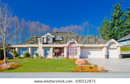 Custom built and nicely landscaped luxury house in a residential neighborhood. Vancouver. Canada. - stock photo