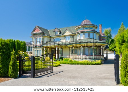Custom built big luxury house in a residential neighborhood. Suburbs of Vancouver (Surrey) Canada. - stock photo