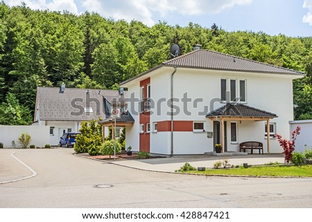 Custom built house view from the street, residential neighborhood, Germany