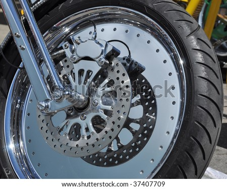 Custom Motorcycle Wheel With Disc Brakes - stock photo