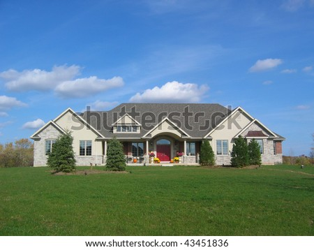 Custom stucco house / home in the country with beautiful green grass. - stock photo
