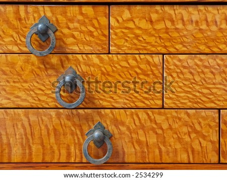 Custom waterfall design drawer detail in lace wood and oak wood, shellac finish - stock photo