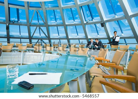 Customary conference room: glassy table, chair, large window - stock photo