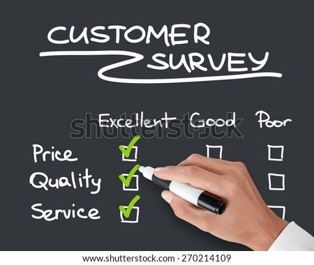 Customer. Business hand evaluate excellence on customer survey form - stock photo