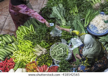 Customer buys food in traditional asian market. - stock photo