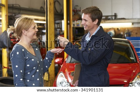 Customer Collecting Car From Garage - stock photo