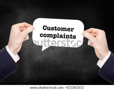 Customer complaints written on a speechbubble - stock photo