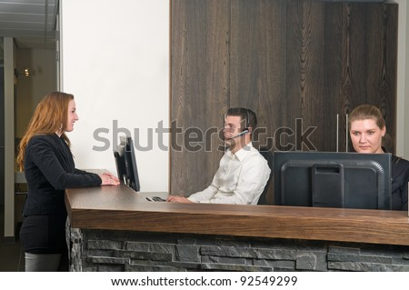 Customer getting some information at a service desk - stock photo